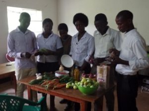 Participants at cooking class, with vegetables